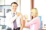 BHPC Medical Director Dr. Nguyen smiles through his flu shot.