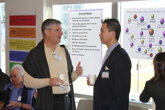 BPHC Medical Director Huy Nguyen spoke to one of the participants, Kevin Hepner, president and CEO of United South End Settlements.
